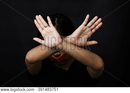Woman Blindfold Wrapping Mouth With Red Adhesive Tape And Show Hand Sign Stop Abusing Violence And A