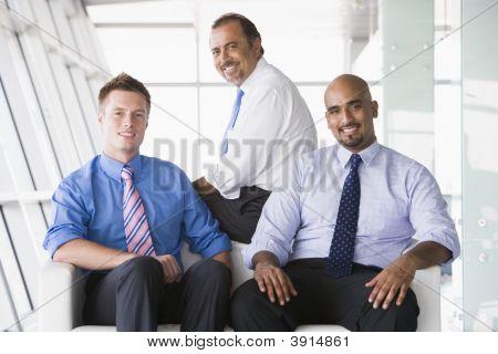 Middle Eastern / Western Business Men Sat On Sofa