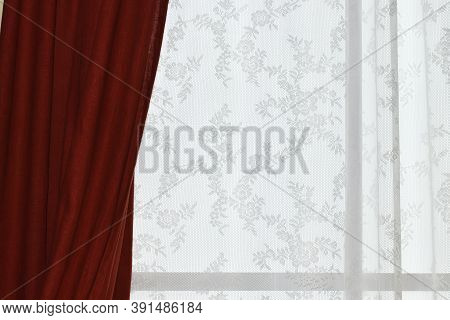Red Curtains On The Window And Light White Lace Tulle. White Tulle On The Window, Place For Text. Th