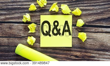Q And A. Notes About Q And A,concept On Yellow Stickers On Wooden Background