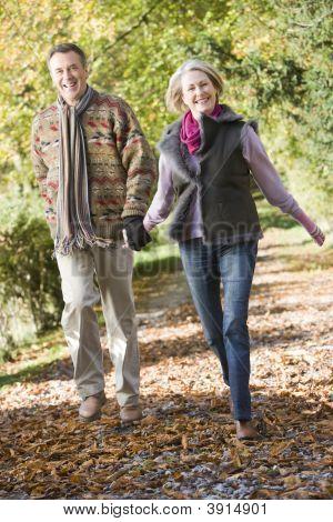 Couple Running Through Woodland