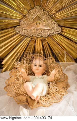 Christmas Scene Baby Jesus Vintage Figurine In His Crib In An Italian Church During Christmas Time