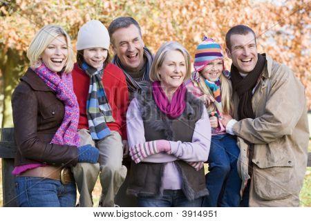 Generational Family On Woodland Fence