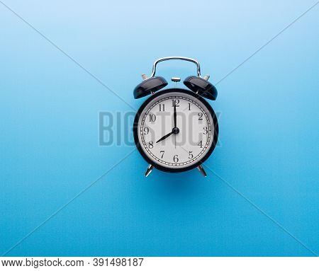 Black Retro Alarm Clock Showing Eight O'clock, Closeup Top View Clipping Path, Isolated On Blue Back