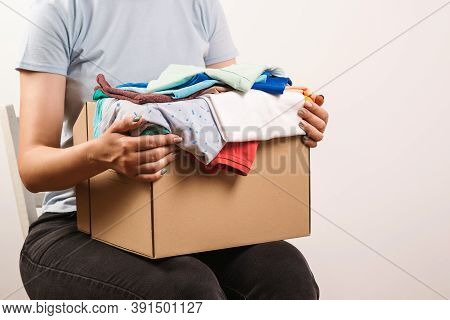 Donation Box For Giving. Sharity Social Activity. Cardboard Box With Clothes For Charity. Female Vol