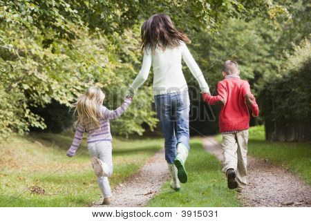 Woman Skipping With Children