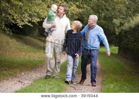 Men And Children On Walk Together