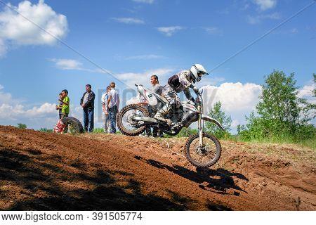 Chapaevsk, Samara Region, Russia - July 09, 2013: Motorbikes In Flight Against The Blue Sky. The Bik