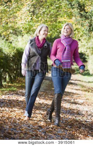 Women Walking Through Woodland