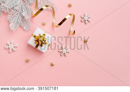 Christmas Ornament With Gold Decorations On Pastel Pink Background