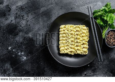 Dry, Raw Quick Cooking Noodle, Instant Noodles. Black Background. Top View. Copy Space
