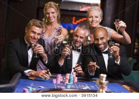 Group Of Adults Playing Roulette
