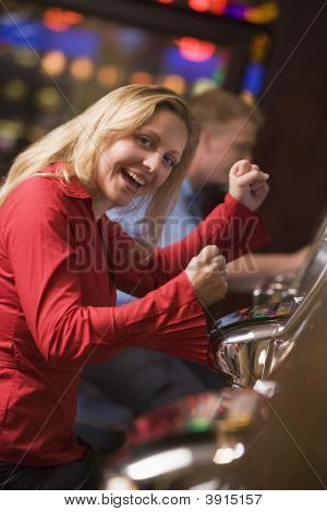 Woman Playing On Games Machines In Casino