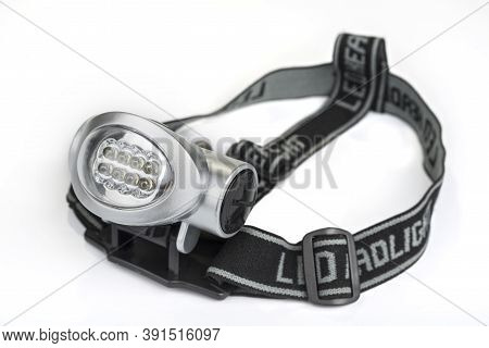 The Led Headlight On A White Background