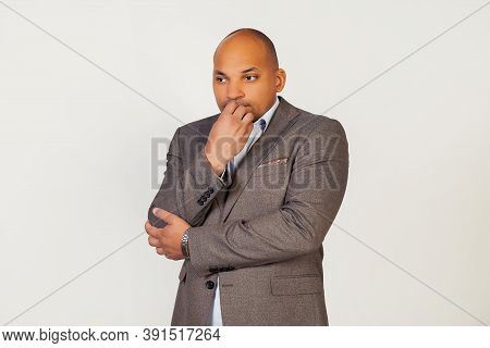 Portrait Of An Unhappy Young African American Guy Businessman, Looks Tense And Nervous With His Hand
