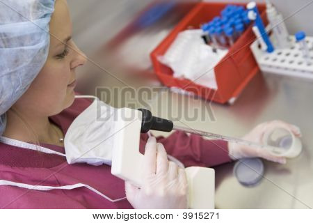 Embryologist Adding Sperm To Egg In Laboratory