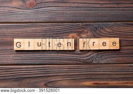 Gluten Free Word Written On Wood Block. Gluten Free Text On Table, Concept