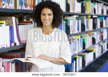 Woman In Library With Book