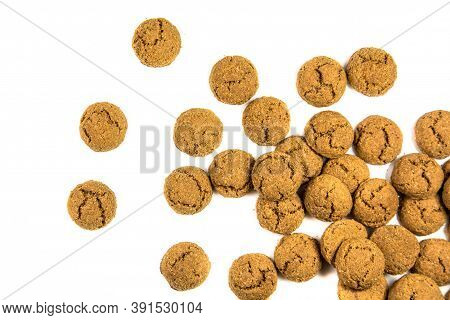 Big Throw Of Scattered Pepernoten Cookies  From Above On White Background For Annual Sinterklaas Hol