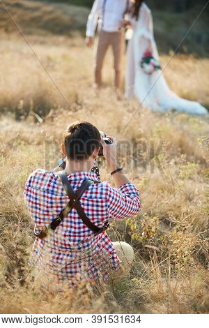 Wedding Professional Photographer Taking Photo Of The Bride And Groom In Nature On The Sunset, Man P