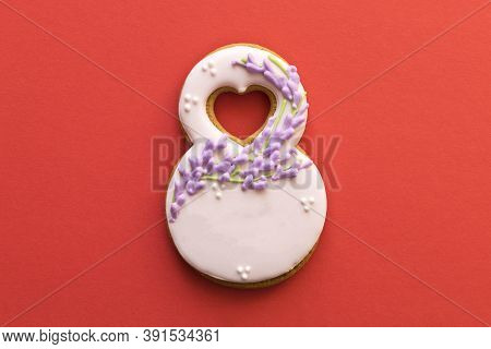 Gingerbread In The Form Of 8 On A Red Background. Concept Of International Women's Day