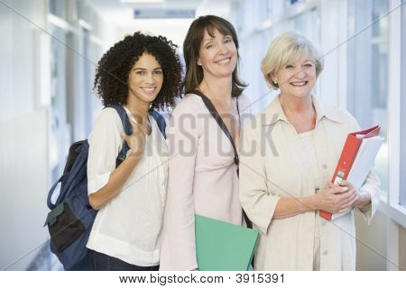 Women Standing In School Corridor