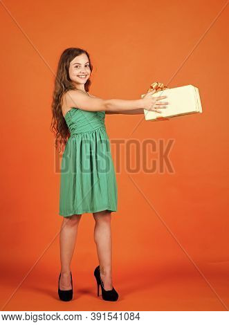 For Me. International Childrens Day. Joyous Female Kid Holding Gift-wrapped Box. Holding Gift In Han