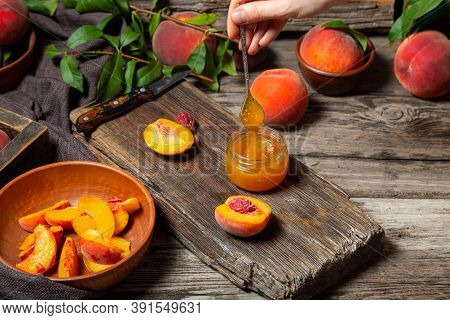The Process Of Making Peach Jam, Cooking Peach Dessert On Rustic Cutting Board By Female Hands. Peac