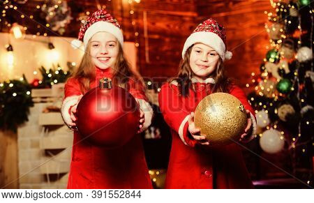 Little Girl Sisters In Red Hats. We Are Family. Elf Children. Xmas. Happy Holiday. Santa Claus Littl