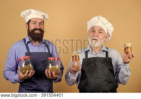 Starting Day With Healthy Food. Professional Cook. Mature Senior Bearded Men In Kitchen. Chef Men Co