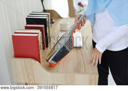 Closeup Active Young Asian Muslim Housewife Woman Hands Cleaning With Vacuum Cleaning Wooden Table W