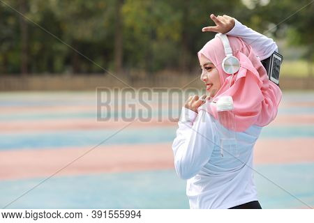 Beautiful Fitness Athlete Asian Muslim Woman Drinking Water After Work Out Exercising. Young Cute Gi