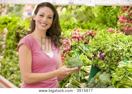 Woman Choosing Vegetables From Shop