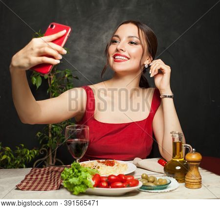 Happy Woman Taking Selfie Photo And Eating Italian Pasta In Restaurant