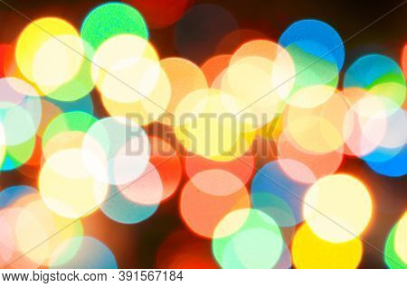 Christmas festive background. Blurred Christmas background, festive Christmas multicolor bokeh background. Holiday Christmas glowing color lights with sparkles, blurred bright Christmas abstract bokeh
