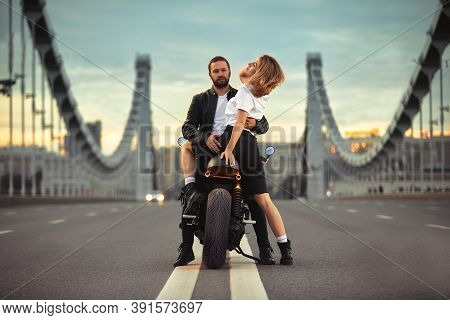 Sexy Couple Of Bikers On The Vintage Motorcycle. Outdoor Lifestyle Portrait, On A Romantic Date.