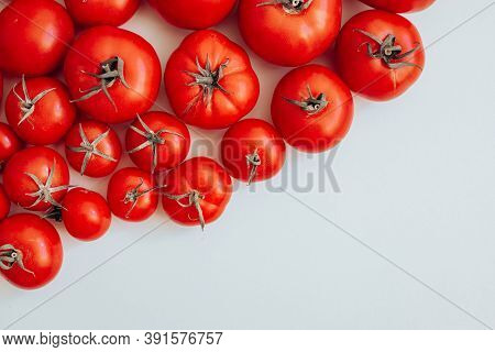 Ripe Tomatoes Of Different Size Pattern On White Background With Copy Space. Organic Vegetables.