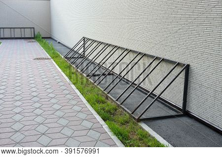 Empty Bike Parking. Parking Space Or Spot For Multiple Bikes. Place For Parking At The House Or Shop