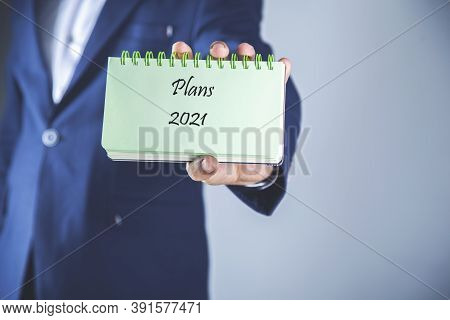 Man Hand Holding  2021 Plans Text On Notepad