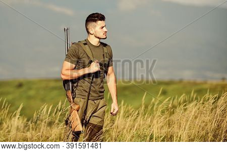 Man Observing Nature Background. Hunter Hold Rifle. Natural Environment. Hunter Spend Leisure Huntin