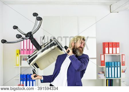 Throw Out Chair. Businessman Standing In Office Hold Chair. Business Man Aggressive. Drive Out Uninv