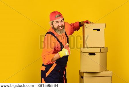 Moving To New Apartment. Post Service. Bearded Loader In Uniform. Real Estate. Moving Day. Renovatio