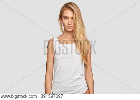 Serious Good Looking Female Model With Long Blonde Hair, Serious Expression, Wears Casual Mock Up Ve