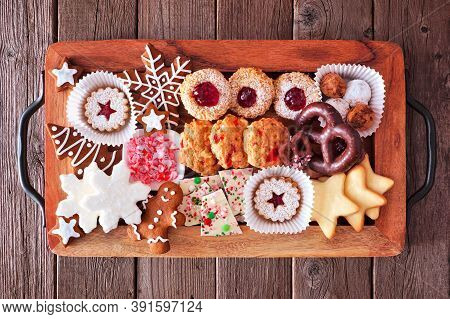 Tray Of Christmas Cookies And Baked Sweets. Top View Over A Rustic Wood Background. Holiday Baking C
