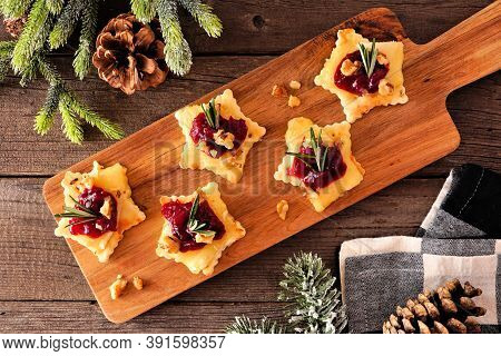Christmas Star Shaped Appetizers With Cranberries And Baked Brie. Overhead View On A Serving Board A