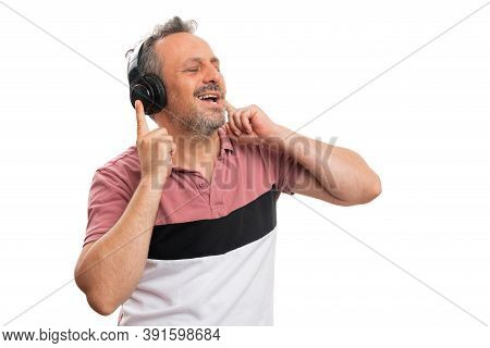 Cheerful Adult Male Model Smiling As Listening To Music In Headphones Singing Dancing Wearing Colour