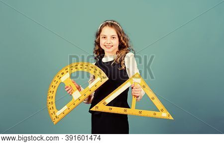 Small Girl Back To School. Stem School Disciplines. Pupil Girl With Big Rulers. Math Lesson. Educati