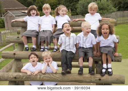 Children Sat On School Play Equipment