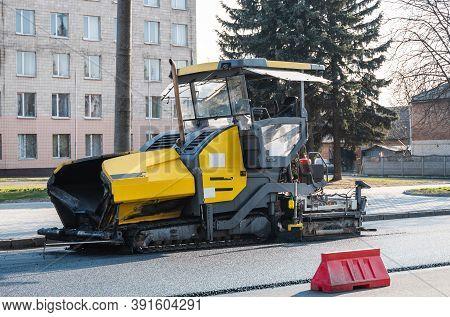 Industrial Asphalt Paver Machine Laying Fresh Asphalt On Road Construction Site On The Street. A Pav