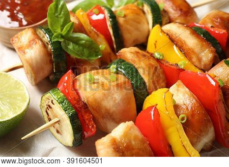 Delicious Chicken Shish Kebabs With Vegetables And Lime On Parchment, Closeup